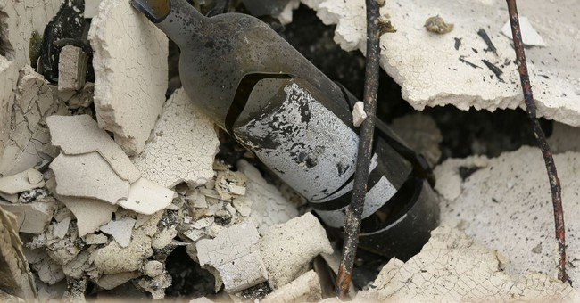 Bottles sucked dry of wine among charred wildfire remains
