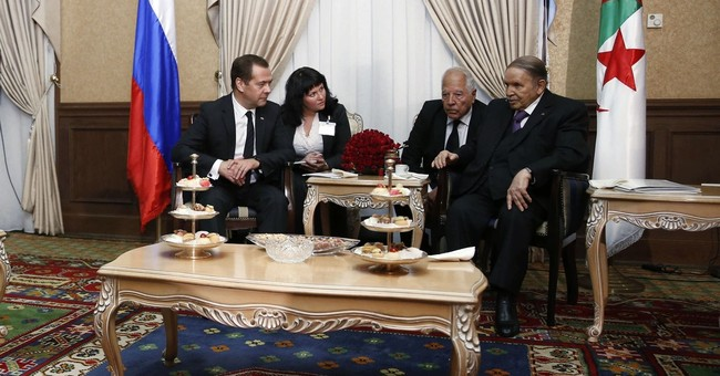 Russia, Algeria vow to push ahead with oil production cuts
