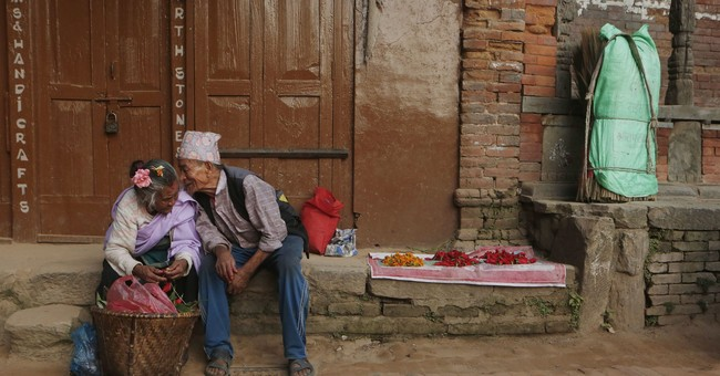 Image of Asia: A whisper between brother, sister in Nepal