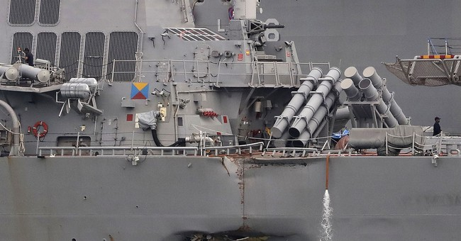 Navy relieves of duties top officers of wrecked US warship