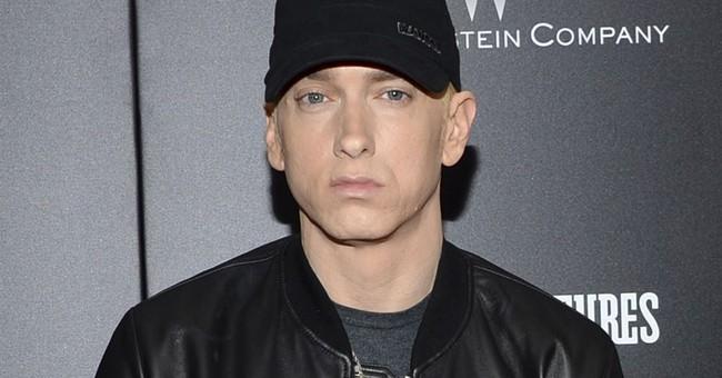 Eminem slams Trump in profane video, calls him racist