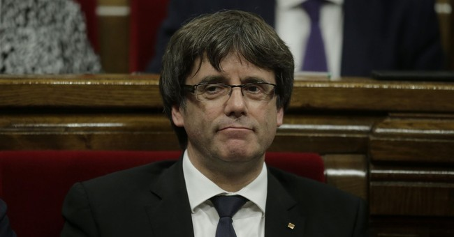 The Latest: Catalan official urges Spain PM to accept talks