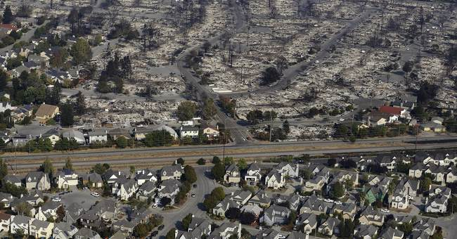The Latest: California wildfires bring record 31 deaths