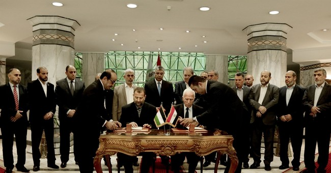The Latest: Hamas, Fatah sign reconciliation deal in Cairo