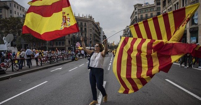 The Latest: Spain: Catalan leader needs to say 'yes' or 'no'
