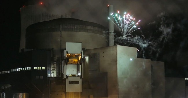 Greenpeace activists light fireworks at French nuclear plant
