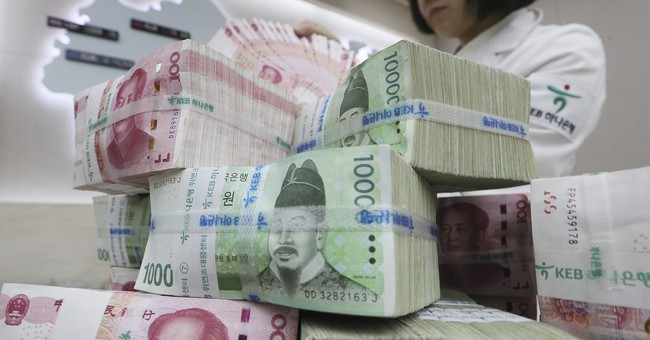 South Korea, China extend currency deal despite missile row