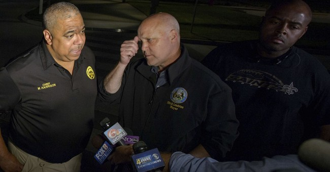 The Latest: Chief: Officer fatally shot during struggle