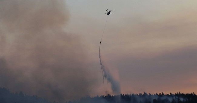 The Latest: Video shows California deputy braving flames