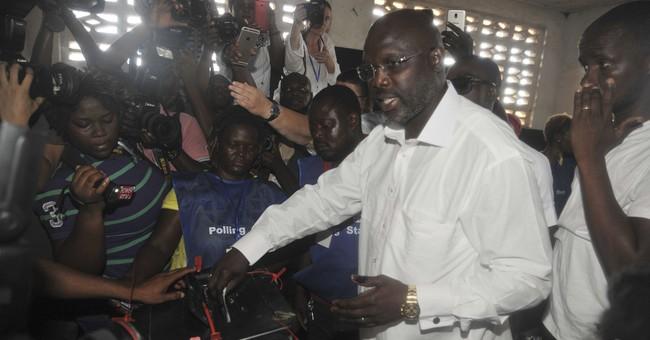 Soccer star still leading in Liberia presidential election