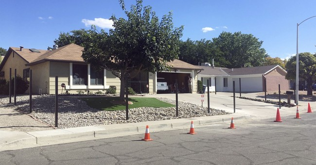 Breaking mad: 'Breaking Bad' house gets fence to block fans