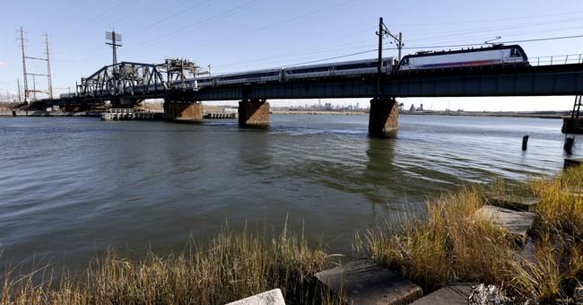 Mock groundbreaking highlights rail bridge's funding issues