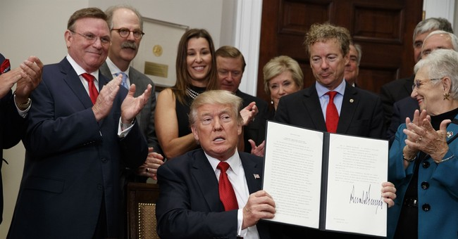AP FACT CHECK: Trump's tax plan, health care distortions