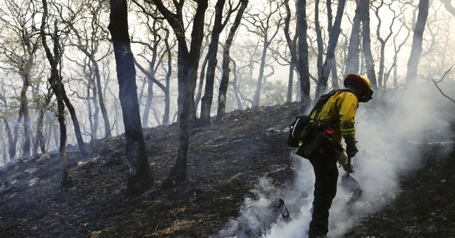 An army of firefighters brave deadly, epic firestorm