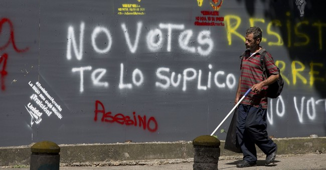The Latest: Venezuela ruling party wins most governor races