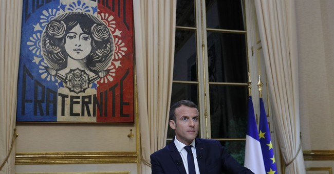 The Latest: France's Macron not worried about Trump