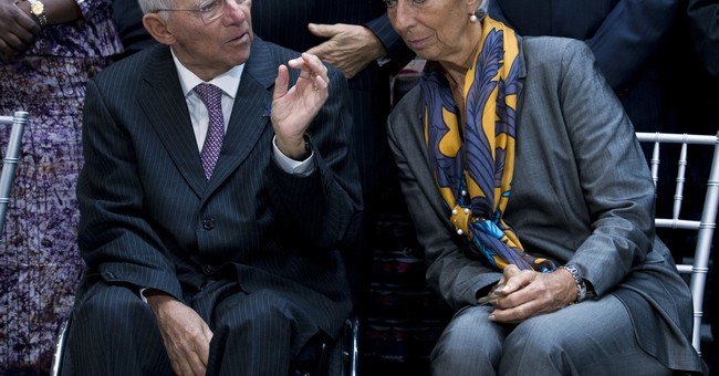 Improving world economy still needs help from low rates