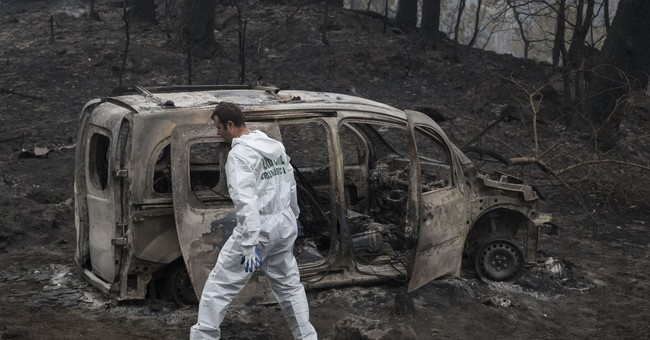 The Latest: Infant dies in Portugal fires; toll rises to 32