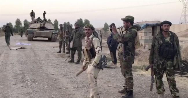 The Latest: Iraqi forces seize oil fields in Kirkuk
