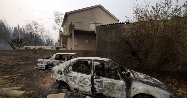 Deadly fires ease, anger grows over Iberia's 45 fire deaths
