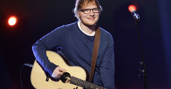 UK singer Ed Sheeran tells fans of bike accident, arm injury