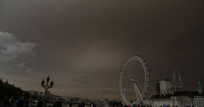 The Latest: Storm blamed for odd odors on British flights