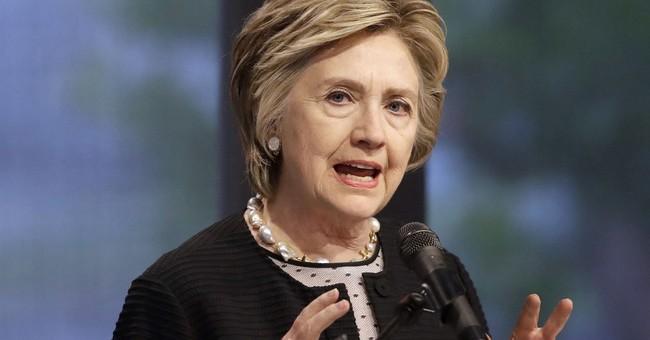 Clinton brands WikiLeaks boss 'tool of Russian intelligence'