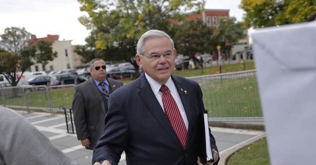 The Latest: Menendez defense calls family members to stand