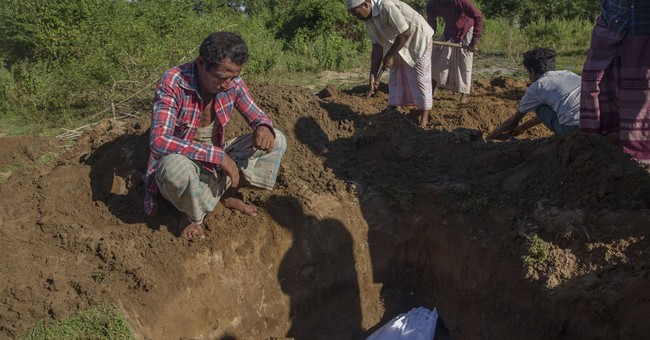 Boat carrying Rohingya Muslims capsizes, killing at least 12