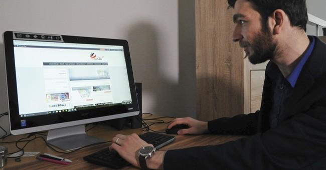 Syrian IT expert extends web lifeline to fellow migrants