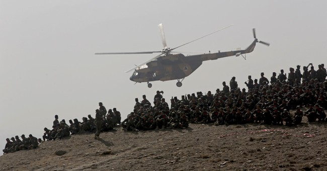 The Latest: Afghan official: Drone strikes kill 35 Taliban