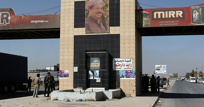 Iraqi gov't assumes control after Kurds leave disputed areas