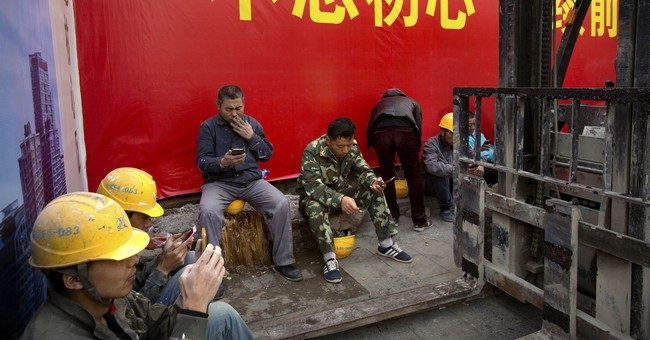 AP PHOTOS: Banners herald China's Communist Party congress