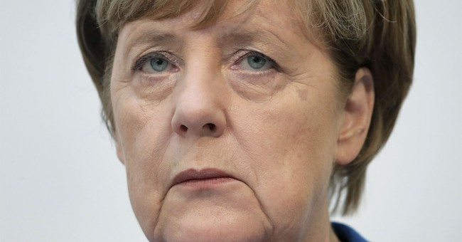 Potential ally urges Merkel to give up finance ministry