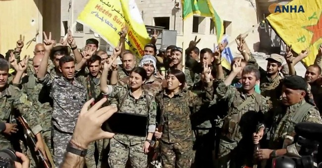 US-backed forces celebrate fall of IS 'capital,' Raqqa