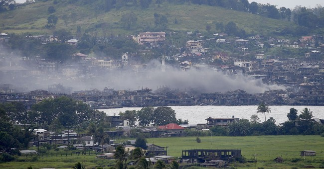 A few militants fight on in Philippine city ripped to shreds