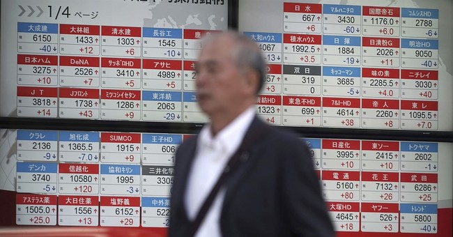 Global stocks mixed, Nikkei up on likely ruling party win