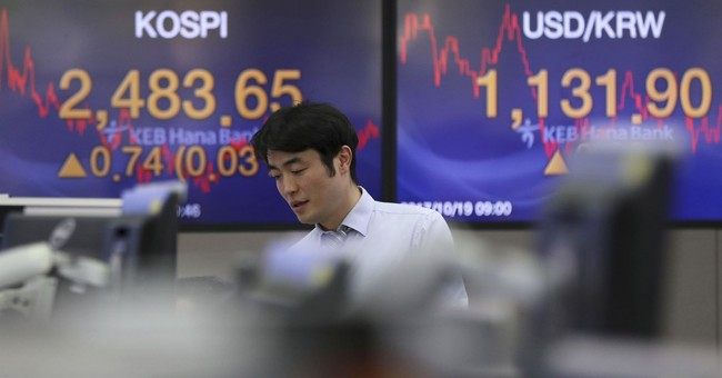 Global stock markets slip as China's growth slows