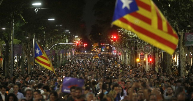 Spanish premier urges Catalan secession leaders to back down