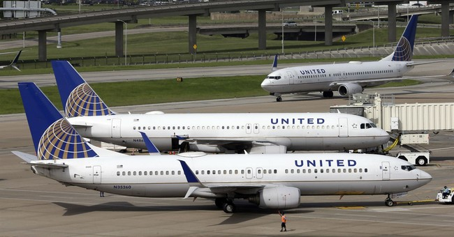 Hurricanes help push down United's 3Q profit by one-third