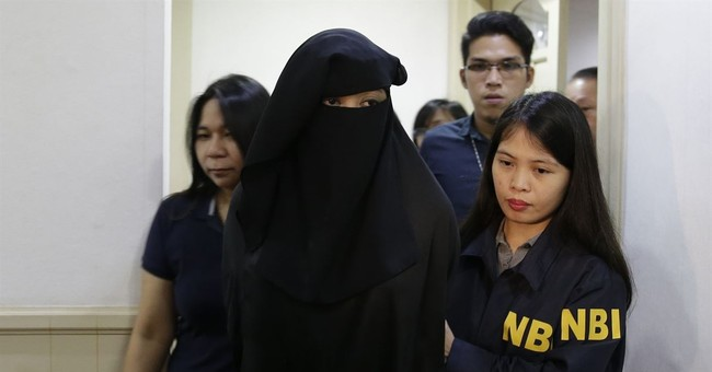 Philippines says militant's widow recruited foreign fighters