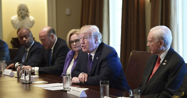 The Latest: Trump warns Democrats about opposing tax plan