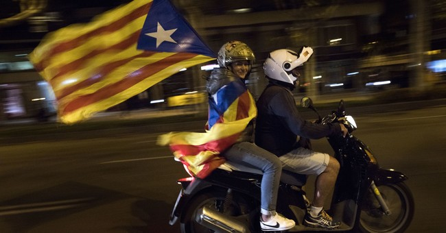 The Latest: Rajoy calls on Catalan leader to act sensibly