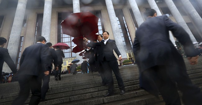 Image of Asia: Delegates arrive in rain at China congress