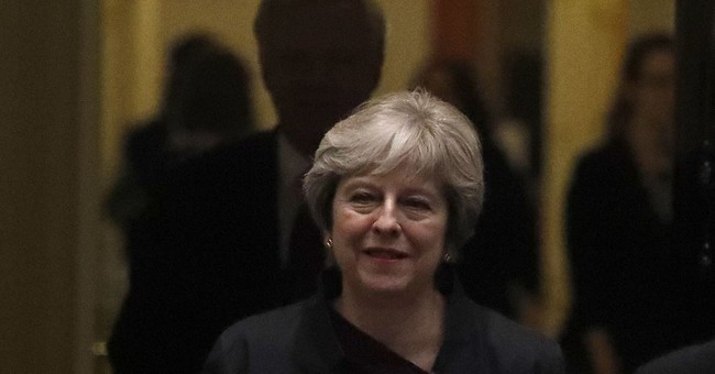 May seeks Brexit momentum with promise to EU nationals in UK