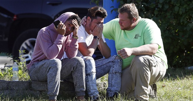 The Latest: Suspect discarded gun, ran when he saw police