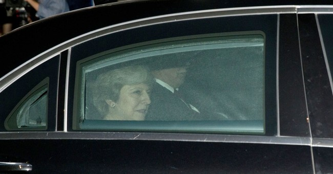 The Latest: Merkel says May's Brexit effort still not enough