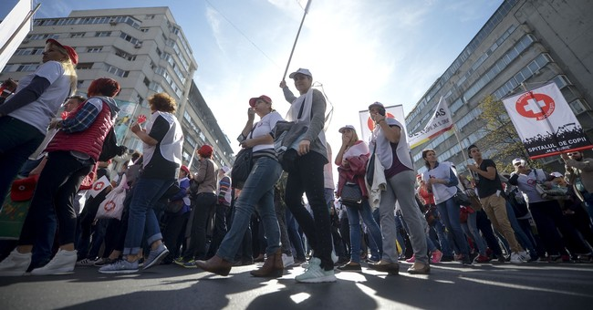Romanian health workers protest against tax plan