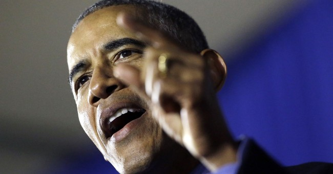The Latest: Obama bemoans rise of racial politics