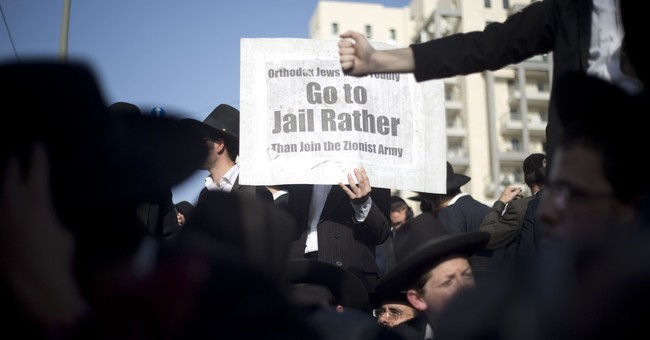 Hundreds of Israeli ultra-Orthodox Jews protest army draft